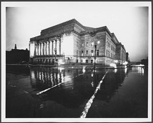 Henry Kiel - Exterior of the Municipal Auditorium and Community Center at night, also known as Kiel Auditorium.