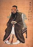 Den kinesiske filosof Konfutse udtænkte tanken om at magt skulle have hjemmel i merit, hvilket dannede baggrunden for udviklingen af et meritokratisk embedssystem i Kina.