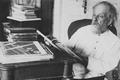 Konstantin Tsiolkovsky in his working room (by Feodosiy Chmil), 1934.png