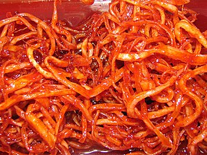 Dried shredded squid - Ojingeochae bokkeum, a Korean dish stir-fried in a sauce based on gochujang (chili pepper paste).