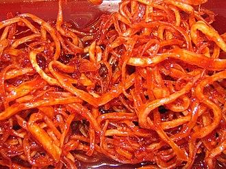 Dried shredded squid - Ojingeochae bokkeum, a Korean dish stir-fried in a sauce based on gochujang (chili pepper paste).