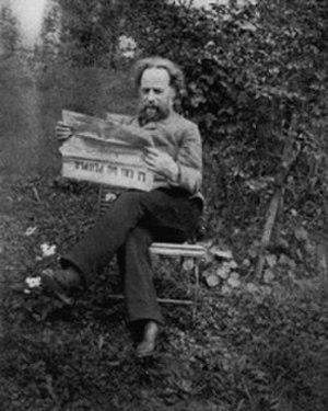 "Élisée Reclus - Reclus reading ""Le Cri du Peuple"" in the garden of his home in Brussels, ca. 1894–1905"