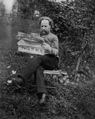 "Élisée Reclus - Reclus reading ""Le Cri du Peuple"" in the garden of his home in Brussels, ca. 1894–1905"