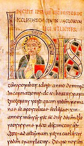 "Illuminated manuscript page; most of its top half is covered by the three letters ""his""; inside the arc of the ""h"" is a bust portrait of a haloed man carrying a red book and a cross with a long handle."