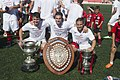 Lincoln Red Imps players with trophies, 2014.jpg
