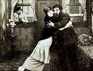 Charlotte Mineau - Eddie Gribbon (in window), Charlotte Mineau, and Kalla Pasha in Love's False Faces (1919)