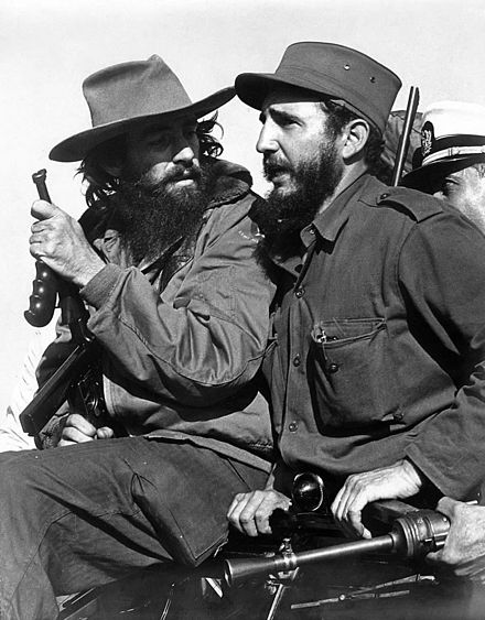 Castro (right) with fellow revolutionary Camilo Cienfuegos entering Havana on 8 January 1959 Luis Korda 02.jpg