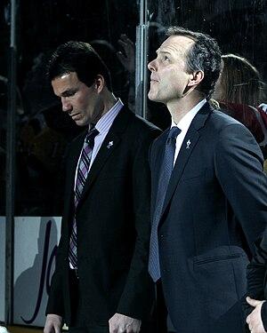 Jon Cooper (ice hockey) - Cooper (right) stands alongside Luke Richardson at the 2013 AHL All-Star Game