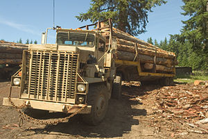 Logging truck - Oshkosh M911 tractor hauling logs