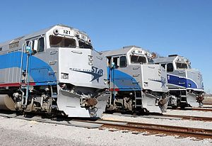Music City Star - Three EMD F40PH locomotives in use by the Music City Star lined up within the Lebanon, Tennessee yards. The third F40PH on the far right is painted in Amtrak Pacific Surfliner scheme.