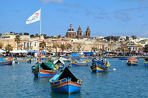 Luzzu - Marsaxlokk Harbour with various luzzus.