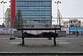 Man sleeping on a public bench in Place Fontainas, Brussels (DSCF5166).jpg