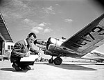 Man with Map next to Lockheed 12A Electra Junior, Delta Air Lines (11429592093).jpg