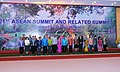 Manmohan Singh and his wife Smt. Gursharan Kaur in a group photo with the ASEANEAS Heads of StateGovernment and ASEAN SG 1st at Gala Dinner for the 21st ASEAN Summit and Related Summits, in Phnom Penh, Cambodia.jpg