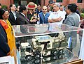 Manohar Parrikar interacting with the Chief of Army Staff, General Bipin Rawat about a replica of Weapon Locating Radar (WLR), Swathi, during the handing over ceremony of the DRDO developed products to the Indian Army.jpg