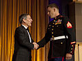 Marine Corps Sgt. Andrew C. Seif, right, shakes hands with President and Chief Executive Officer of the USO Sloan D. Gibson before receiving the USO Marine of the Year award from the Assistant Commandant of 131025-M-KS211-016.jpg