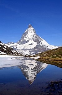 East face of the Matterhorn reflected in the Riffelsee lake