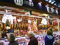 Meat stall at Barcelona market (2924623965).jpg