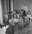 Members of the public enjoying a meal in one of the chain of British Restaurants established during the Second World War, London, 1943. D12268.jpg
