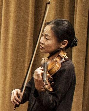 Midori Gotō - Midori instructing a student during rehearsal in 2013.
