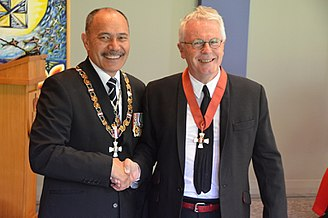 Mike Chunn - Chunn (right) in 2015, after his investiture as a Companion of the New Zealand Order of Merit by the governor-general, Sir Jerry Mateparae
