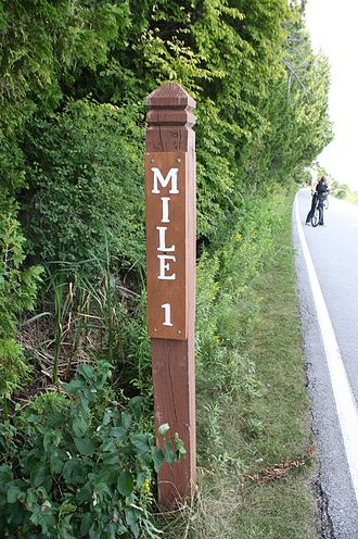 M-185 (Michigan highway) - Newer milemarker sign erected along the highway in 2011