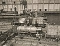 Military Administration - Transportation - Rail - Rolling Stock - LOADING CONSOLIDATED LOCOMOTIVES ABOARD S.S. FELTORE, N.Y. Placing cables on locomotive preparatory to hoisting - NARA - 45501987 (cropped).jpg