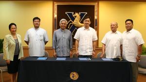 Saint John the Baptist Catholic School - XS signs a MOA with SJBCS