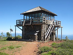 A medium-size two-level structure: the lower level is stone and the upper level is wooden.