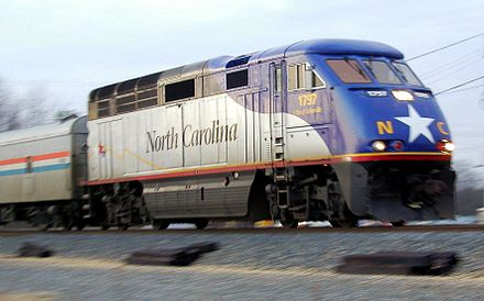 Amtrak's Piedmont near Charlotte, North Carolina with a state-owned locomotive. This route is run under a partnership with the North Carolina Department of Transportation, 2003 NCF59.jpg