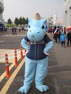 Dinos mascot, Dandi, poses in front of the Masan Baseball Stadium.