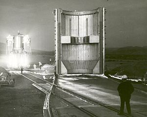 "Nuclear thermal rocket - 1 December 1967: The first ground experimental nuclear rocket engine (XE) assembly is shown here in ""cold flow"" configuration, as it makes a late evening arrival at Engine Test Stand No. 1 at the Nuclear Rocket Development Station in Jackass Flats, Nevada."