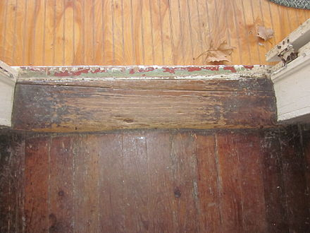 A worn-out wooden threshold NMP 1780s House interior Door Sill.JPG