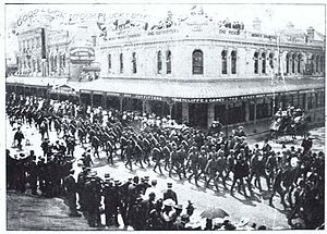 Queen Alexandra's Mounted Rifles - The New Zealand Rough Riders marching through Christchurch before leaving for the Boer War. Sir George Grey Special Collections, Auckland Libraries, 69-2.