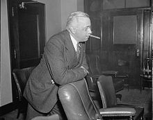 Norman S. Case smokes a stogie.jpg