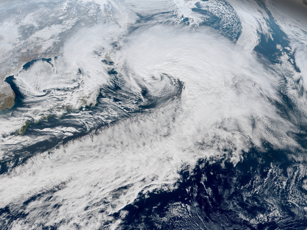 A powerful extratropical cyclone over the North Pacific Ocean in January 2018, with an eye-like feature and a long cold front extending to the tropics Northwest Pacific cyclone 2018-01-23 0230Z.png