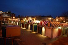 Parallel rows of market stalls with multi-coloured roofs