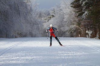 Lise Meloche - Olympic skier Lise Meloche in Gatineau Park, Quebec, ski skating on crusty snow after an ice storm.