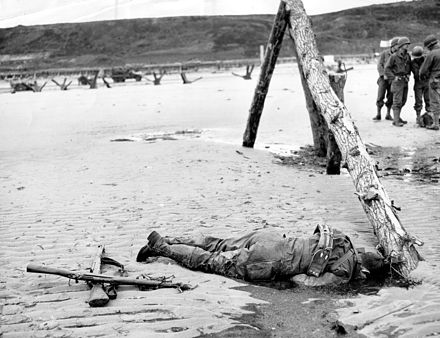 An American casualty of the morning's battle Omaha Beach American Casualty.jpg