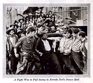On the Night Stage (1915 film) - Film still with Hart (at left with clenched fists) at the fight in Nevada Ned's Place