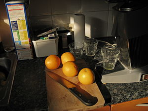 Oranges and juicer in chiaroscuro