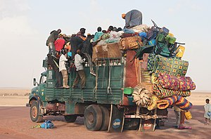 Transport in Mauritania - A truck in Mauritania carrying a lot of people and goods