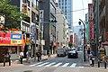 PEOPLE WAITING TO CROSS A STREET IN TOKYO 2017.jpg