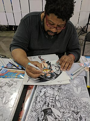 Paris Cullins - Paris Cullins colors an original sketch of Wonder Woman at Wizard World Philadelphia on June 2, 2017.