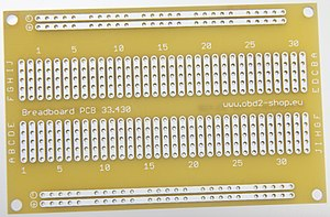 Breadboard - Electrical equivalent printed circuit board (PCB) of the above solderless breadboard