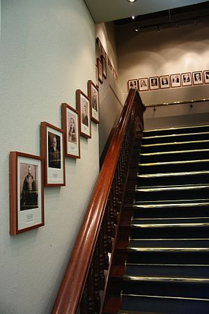 Perth Town Hall - Looking up the jarrah staircase; photographs on the wall are of each Lord Mayor of Perth, starting with George Shenton