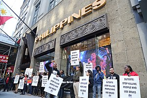 Philippine Drug War - Protest against the Philippine war on drugs in front of the Philippine Consulate General in New York City. The protesters are holding placards which urge Duterte to stop killing drug users.