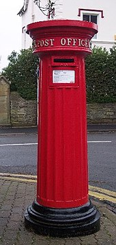 Photo of a Victorian cast iron readitional red letterbox still in use