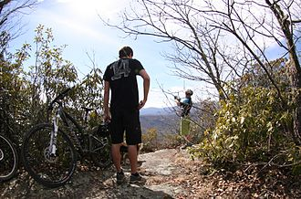 Pisgah National Forest - View from Black Mountain Trail in Pisgah National Forest. Mountain bikers take a break near the summit of Black Mountain.