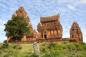 Art of Champa - The profile of the 13th-century temple Po Klong Garai near Phan Rang includes all the buildings typical of a Cham temple. From left to right one can see the kalan, the attached mandapa, the saddle-shaped kosgrha, and the gopura.